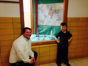 Dan Arrison, left, and a student show off the Lego Project at Grace Park Elementary School.